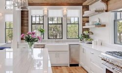 White modern kitchen with wood accent wall